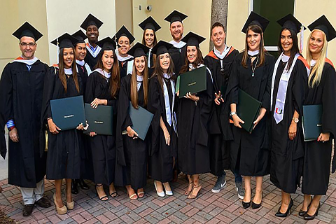 A group of Master of Arts in International Administration students at their graduation ceremony.