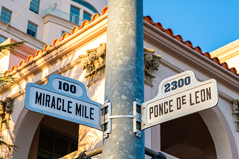 An up close image of street signs in Coral Gables, Florida.