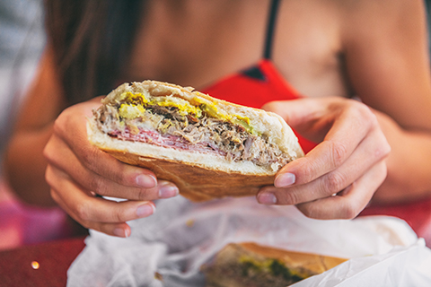 An up close photo of a traditional Cuban sandwich.