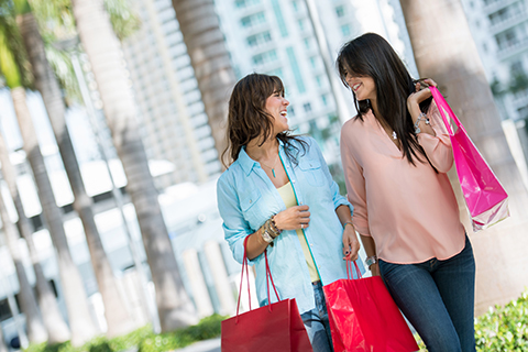 A stock photo of two women shopping in Miami, Florida.