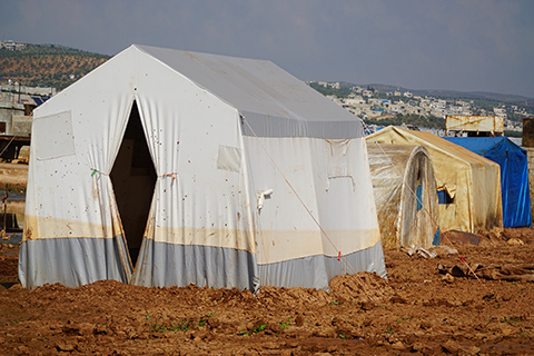 A stock photo of tents in a refugee camp.